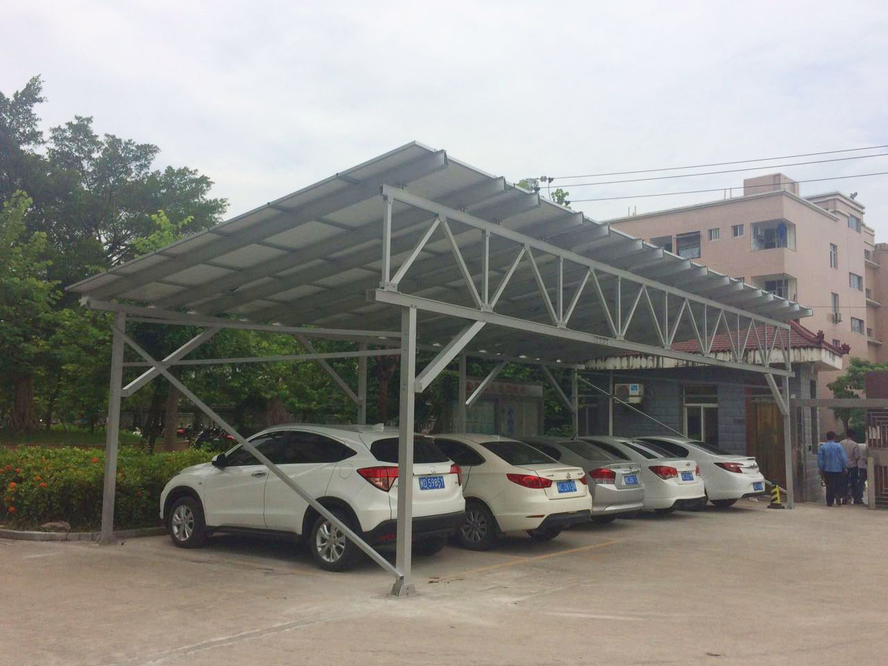 The 12.96KW solar carport covers an area of 83.13 square meters with panel facing southwest is expected to generate 15000 kilowatt annually. & Solar Carport Appears Inside Antaisolar Factory